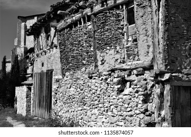adobe facades, street, arcades, typical buildings, Calatañazor, Soria, Spain, series of black and white artistic photographs