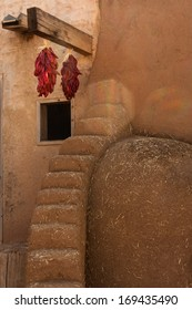 Adobe house with chilli ristras, New Mexico