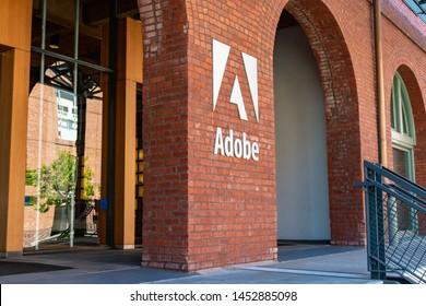 Adobe logo on the brick facade of computer software company office - San Francisco, California, USA - July 12, 2019
