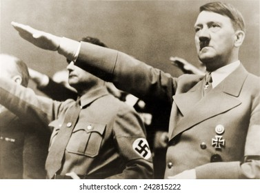 Adolf Hitler, giving Nazi salute. To Hitler's right is Rudolph Hess. 1939.