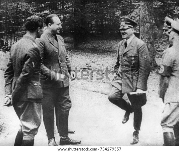 Adolf Hitler happily dances a jig before signing of the World War 2 French Armistice, June 22, 1940.With his staff, Hitler was in Le Francport, Compiegne, where defeated Germany signed the armistice m