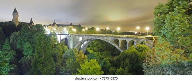 Adolphe Bridge in Luxembourg at night. The iconic arch bridge has been serving the city state since 1903.