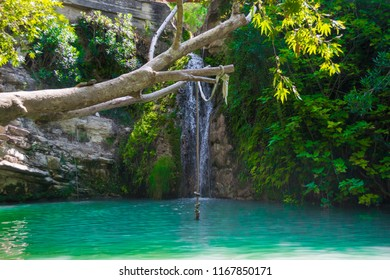 Adonis baths in Paphos Cyprus, very famous tourist destination, the rope and the tree are very fun to jump in the water and visitors love it