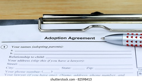 An adoption agreement waiting for you to be signed.
