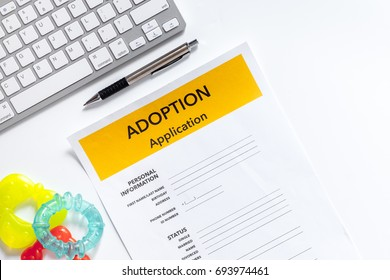 Adoption application near paper silhouette of family and toys on white background top view copyspace