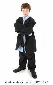 Adorable 10 year old american boy in baggy suit over white background.