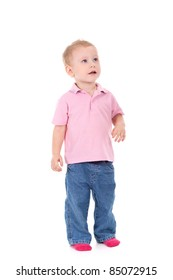 Adorable 2 year old boy looking up over white background