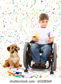 Adorable 2 year old child with wheelchair painting with dog over paint splatter background.