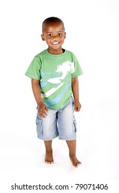 Adorable 3 year old african american or black boy standing and smiling
