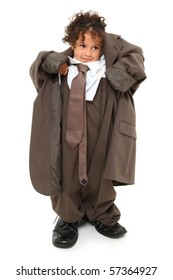 Adorable 3 year old mixed race girl in over-sized baggy suit over white background.