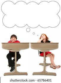 Adorable 7 year old boy and girl in old school desk over white background. Thought bubble.