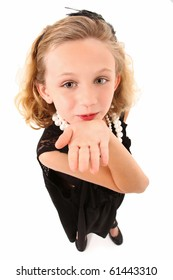 Adorable 7 year old girl in over sized dress and shoes over white background.