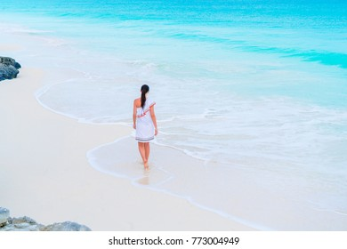 Adorable active girl at beach during summer vacation