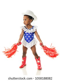 An adorable African American 2 year old shaking her pom-poms while in a wester star studded red, white and blue outfit.