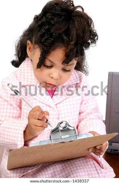 Adorable African American child in business suit with clipboard and laptop in background