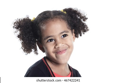 Adorable african little girl with beautiful hairstyle isolated o