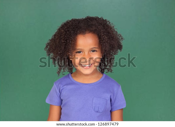 Adorable african little girl with beautiful hairstyle and a blackboard of background