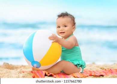 Adorable African-American girl playing on beach