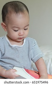 Adorable Asian baby boy playing,crawling in parent bed.