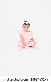 Adorable Asian baby girl is portrait on white background