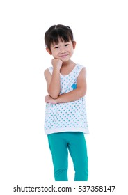 Adorable asian girl thinking and smiling. Thoughtful child looking at camera, isolated on white background. Positive human emotion, facial expression feeling reaction. Studio shot.