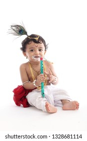 Adorable baby boy dressed up as Little Krishna