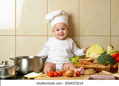 Adorable baby boy in kitchen