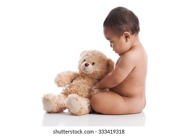 Adorable baby boy playing with a teddy bear.  Isolated on white with room for your text.