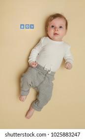 Adorable baby boy portrait - full length