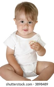 Adorable baby boy sitting up eating sandwich