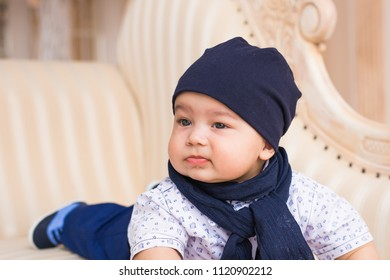 Adorable baby boy in sunny bedroom. Newborn child relaxing