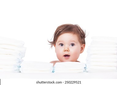 Adorable baby with bunch of diapers
