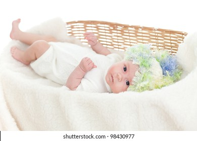 adorable baby dressed cap in a wicker basket