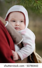 Adorable baby girl in a baby carrier