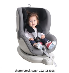 Adorable baby girl in child car safety seat on white background