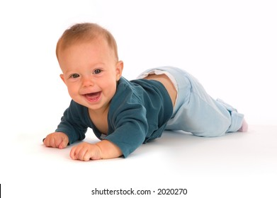 Adorable baby girl crawling and smiling. Smile shows the beginning of two lower front teeth.