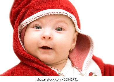Adorable baby girl dressed in red costume