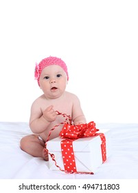 Adorable baby girl  with gifts  on a white background
