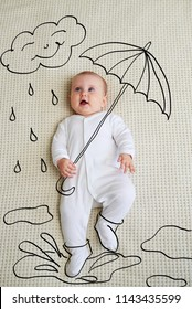 Adorable baby girl sketched as holding umbrella