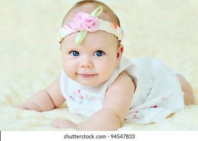 adorable baby girl wearing white dress