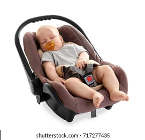 Adorable baby with pacifier sleeping in child safety seat isolated on white