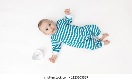 Adorable baby and paper boat
