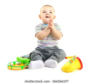 Adorable baby with plastic colourful musical toys isolated on white background