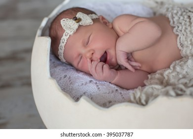 adorable baby sleeping in egg staying in nest easter inspiration