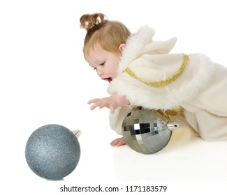 """An adorable baby """"snow princess"""" crawling after a big, sparkly blue Christmas bulb.  On a white background."""