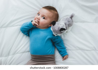 adorable baby sucking his hand