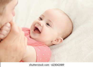 Adorable baby with young father, closeup