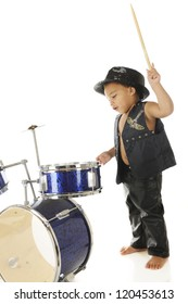 """An adorable, barefoot preschooler dressed as a rock star with a drum stick poised high over a drum set, ready to """"wham"""" it.  On a white background."""