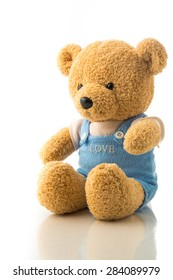 An adorable bear doll with the word LOVE in its chest in white isolation.