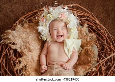 Adorable beautiful newborn baby girl. Maternity and newborn concept. Newborn baby on beautiful background is looking in the camera